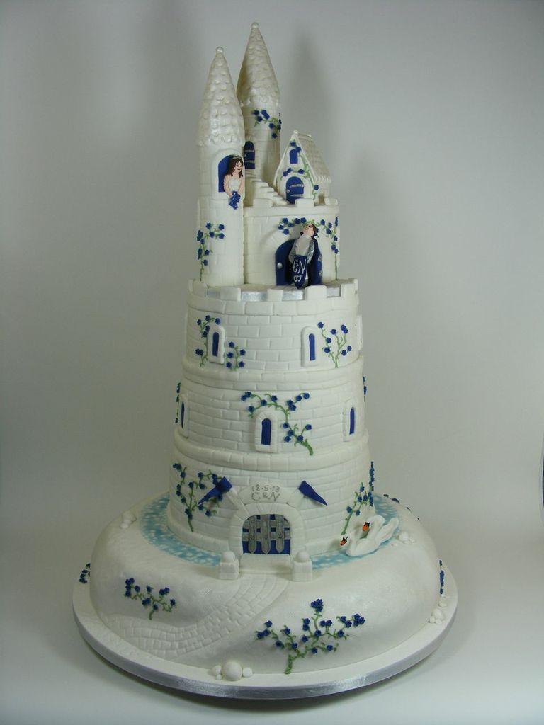 royal blue fairy castle wedding cake - cut above cake co.
