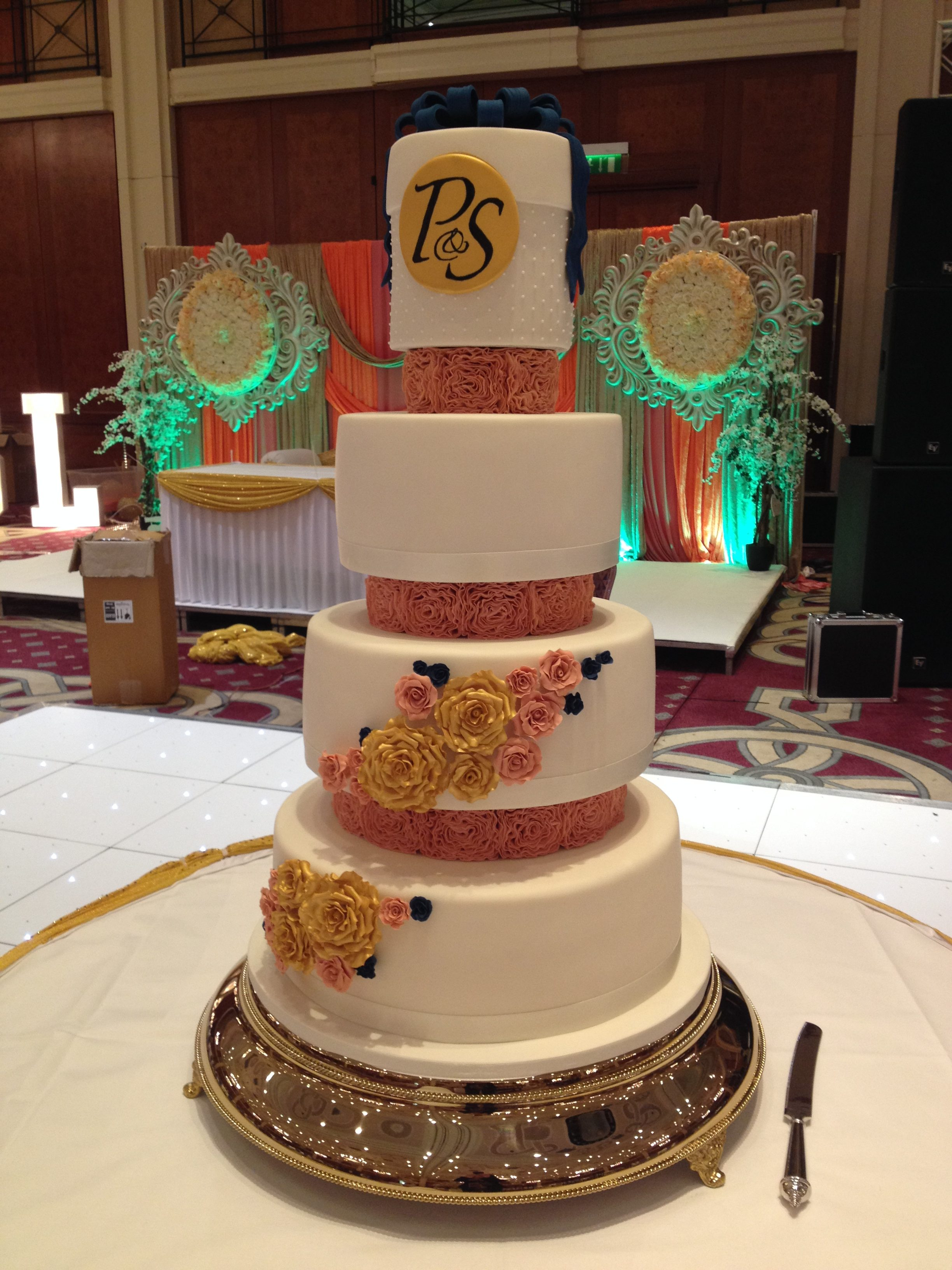 Coral Rosette Column Wedding Cake