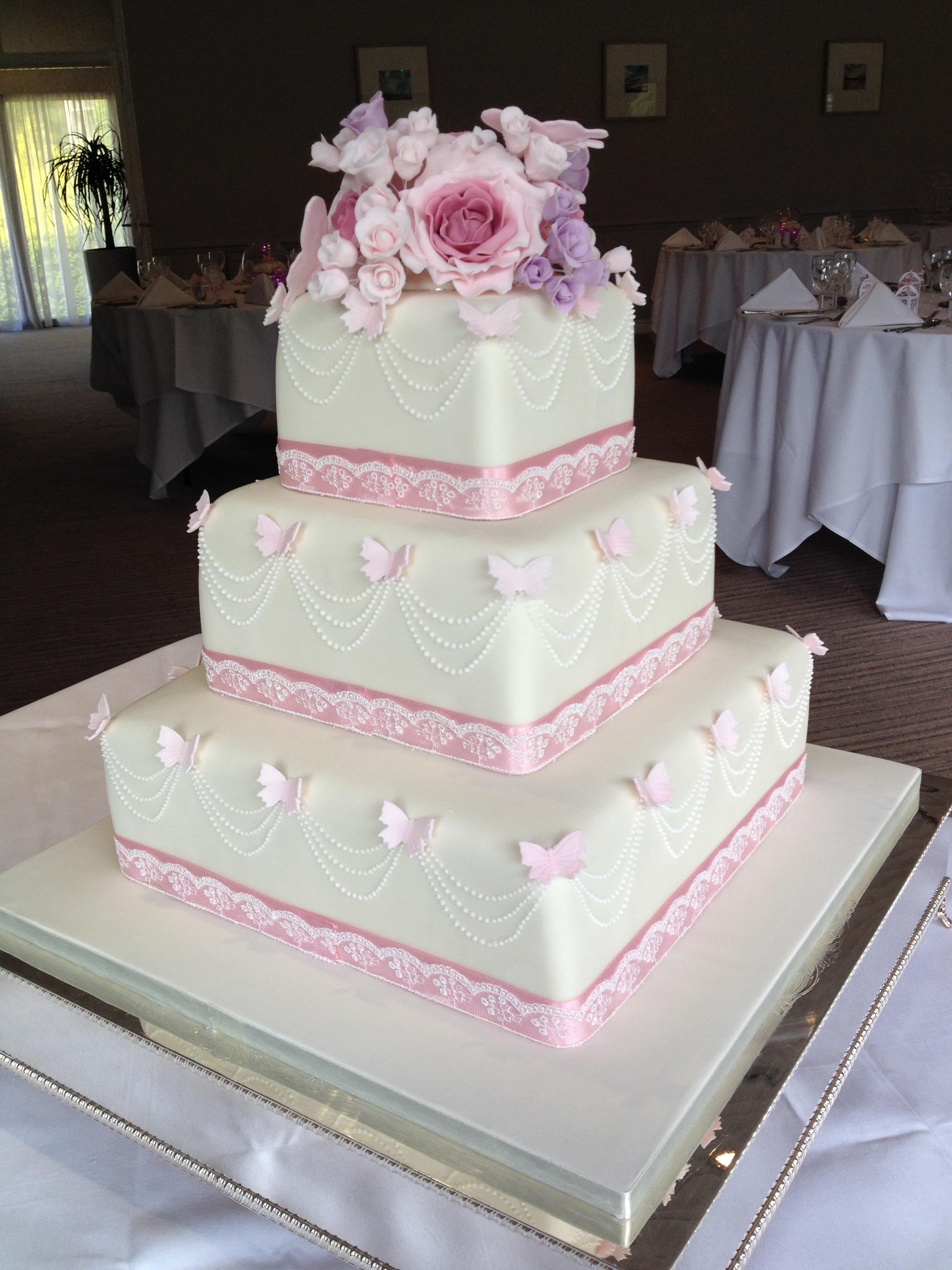 Draped Pearls & Butterflies Wedding Cake