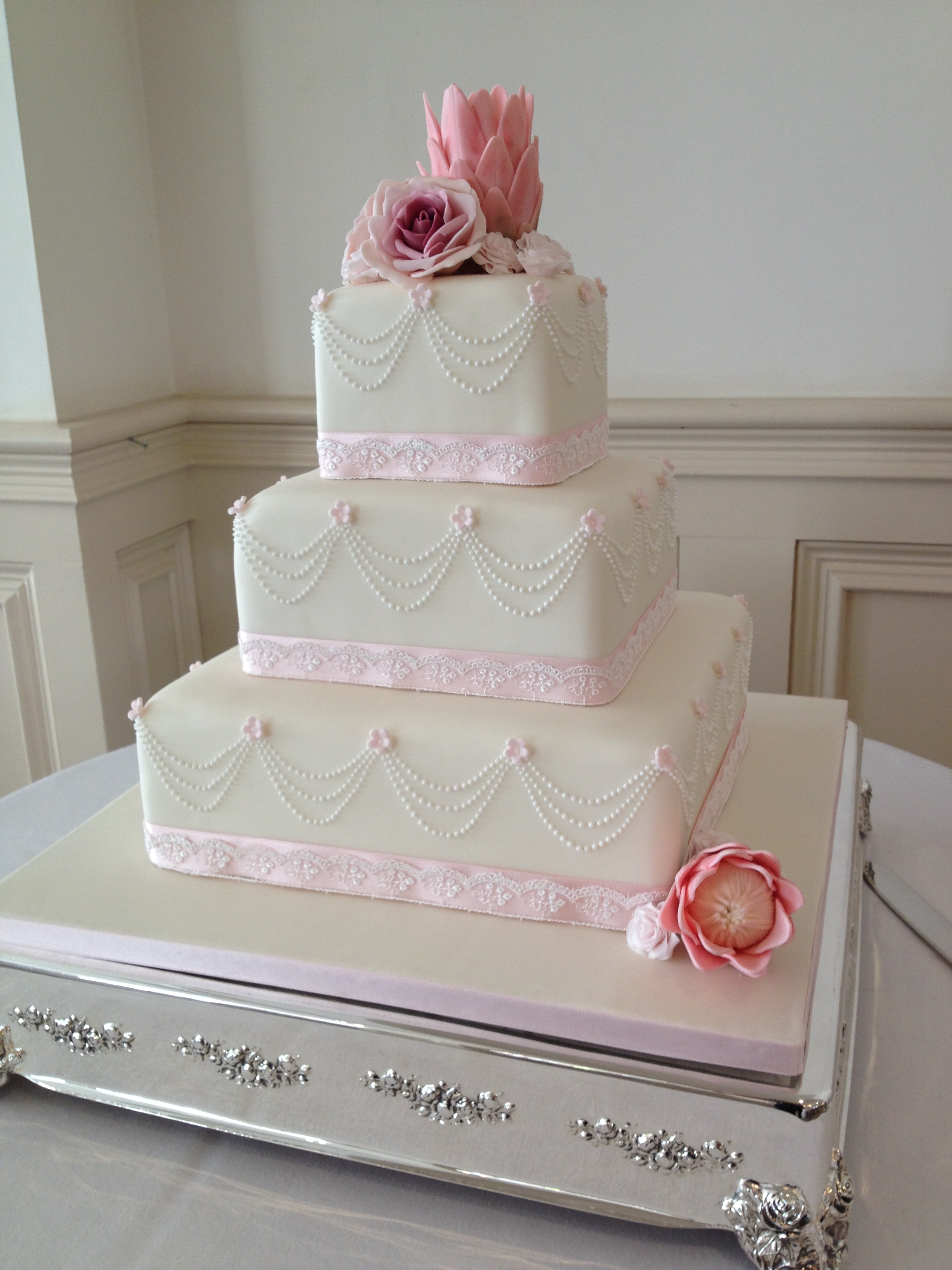 Draped Pearls w: Proteas Wedding Cake