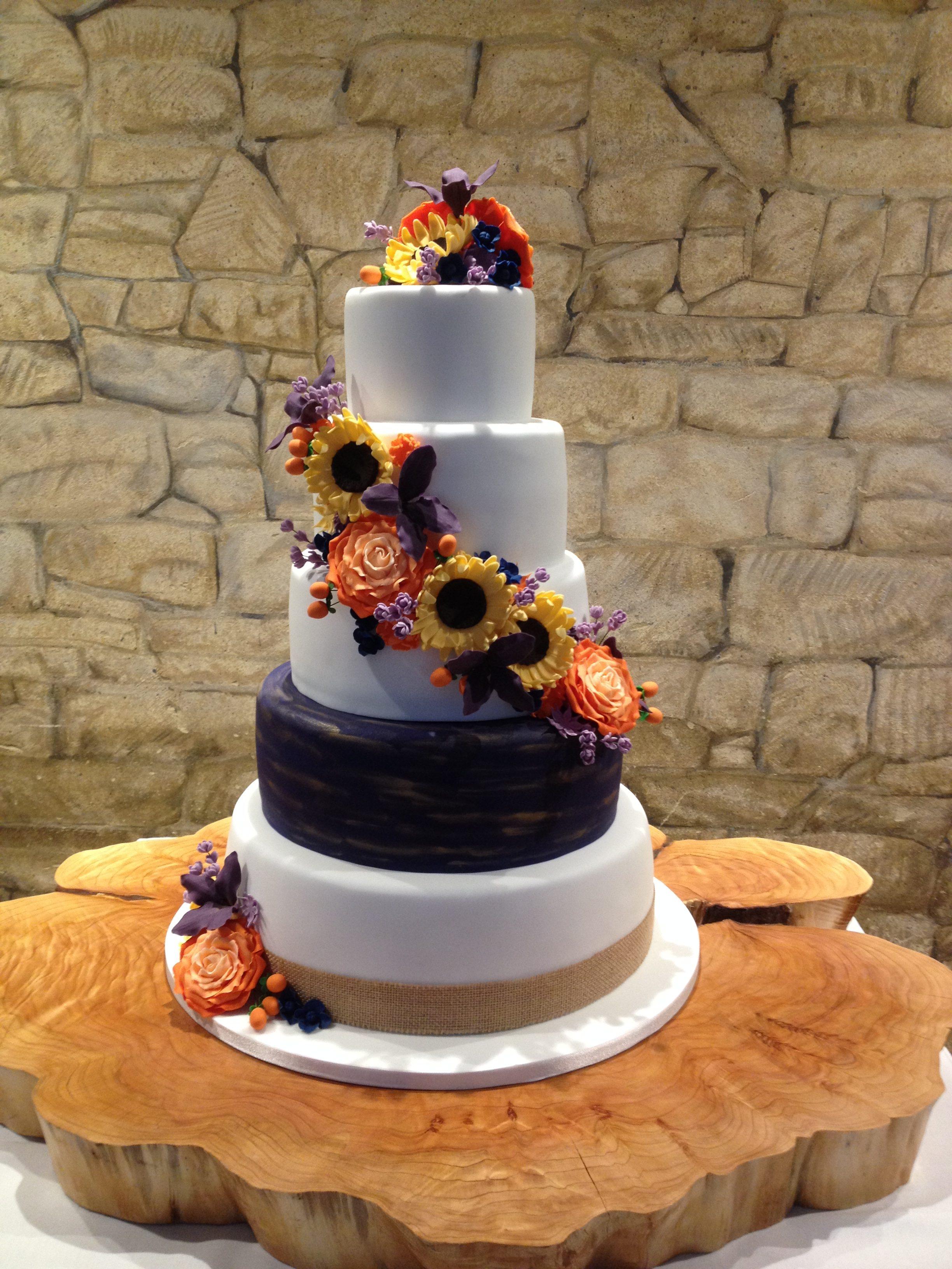 Navy & Bright Flowers Wedding Cake